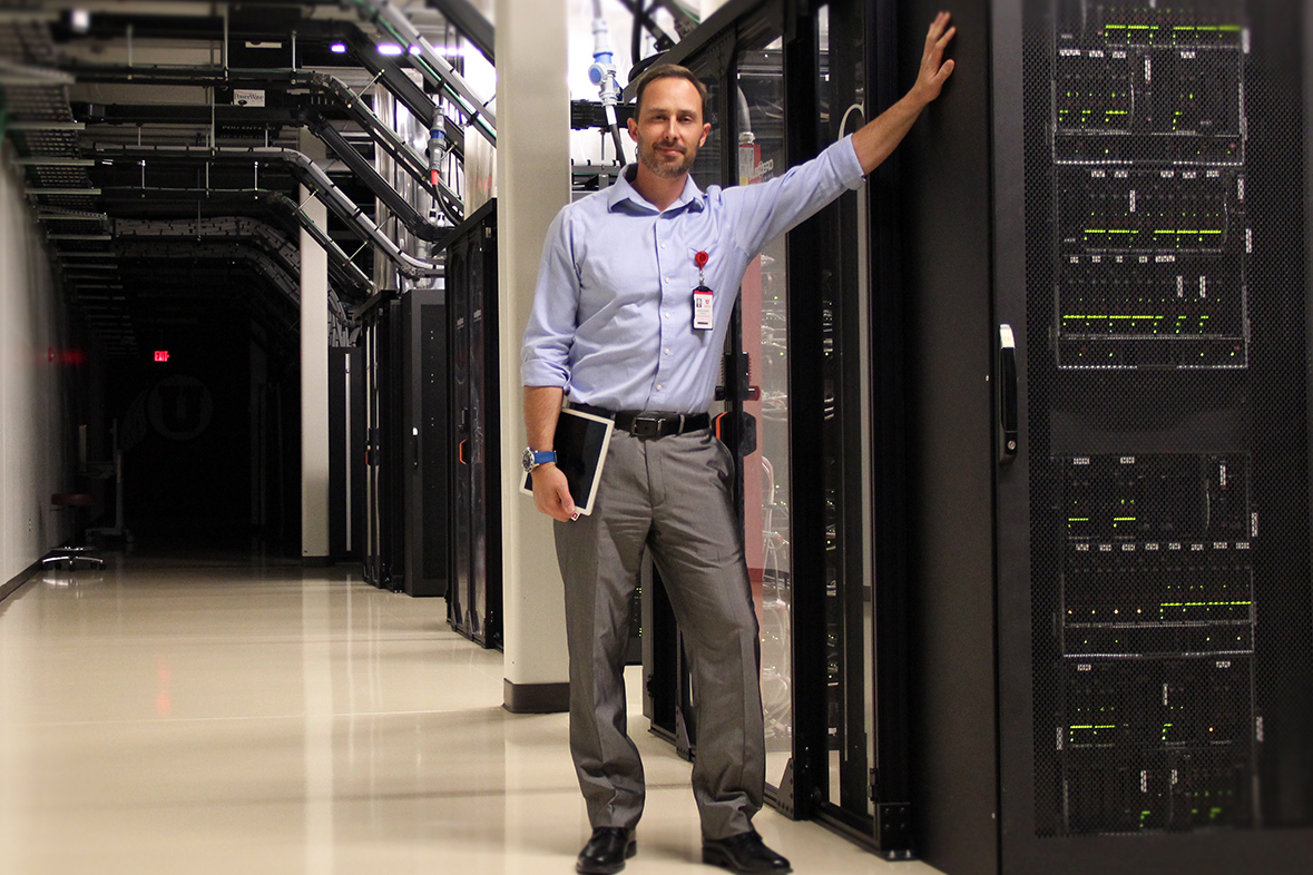 Chris Pedersen, operations specialist at the University of Utah's Downtown Data Center, stands inside the DDC's main production area on October 18, 2018.